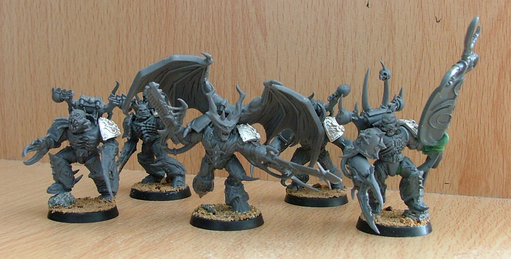 The Possessed Marines in this picture have been based with sand and stuck to their bases before being undercoated.