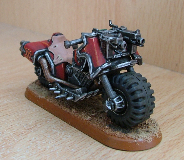 A finished bike sits on a base like the one shown in the article.