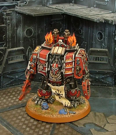 This dreadnought has the head of a battle sister sitting on a rock...